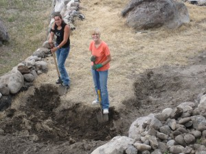 Sonja and Jeanette trying to dig rocks out